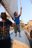 Egyptian boy on boat royalty free stock photos