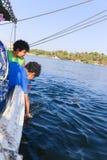 Egyptian boys on boat stock photo