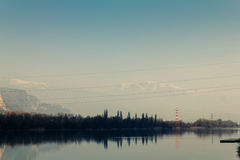 Beautiful nature with power lines. Power lines overlapping on a beautiful landscape Royalty Free Stock Images