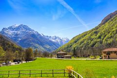 Beautiful nature scenery of snow capped mountain. And small village, view from Sonogno in Locarno district, Switzerland Royalty Free Stock Images