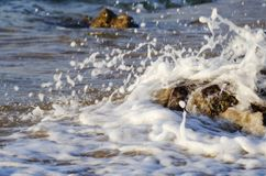 Beautiful nature, splashing wave while hitting the rock Stock Photography