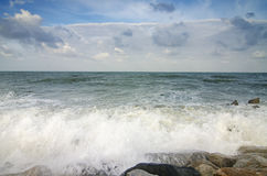 Beautiful nature, splashing wave while hitting the rock at the beach Stock Photography