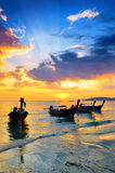 Traditional thai boats at sunset beach Royalty Free Stock Photography