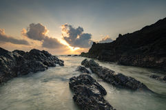 Beautiful nature of unique rocks formation at Pandak Beach located in Terengganu,Malaysia over stunning sunrise background. Royalty Free Stock Photography