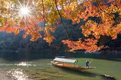 Beautiful nature view of Arashiyama in autumn season along the river. In Kyoto, Japan. Arashiyama is a one of attraction landmark for tourist in Kyoto, Japan Royalty Free Stock Photography