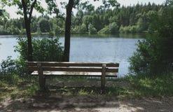 Beautiful nature wooden bench at a wonderful day at sea Stock Image