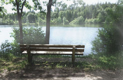 Beautiful nature wooden bench at a wonderful day at sea Royalty Free Stock Images