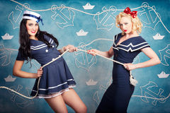Beautiful navy pinup girls on marine background Royalty Free Stock Photos