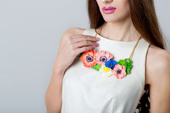 Beautiful necklace bizhueriya of flowers around the neck of a beautiful elegant girl Stock Images