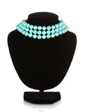 Beautiful necklace of blue pearls on a mannequin Royalty Free Stock Photo