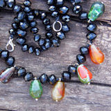Beautiful necklace of jasper and black quartz beads Stock Photo