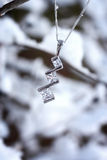 Beautiful necklace in snowy scene Royalty Free Stock Photo
