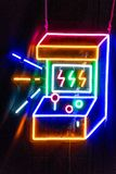 Neon lights of arcade machine. Beautiful neon lights sign of an arcade machine Royalty Free Stock Photography