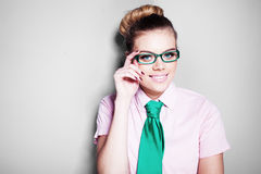 Beautiful nerdy young woman in glasses Stock Photo