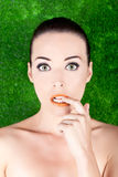 Beautiful nervous woman biting her finger. Closeup portrait of a beautiful nervous woman biting her finger isolated on green Stock Photo