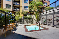 Beautiful new apartment building, the outdoor swimming pool. Stock Photography