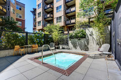 Beautiful new apartment building, the outdoor swimming pool. Royalty Free Stock Image