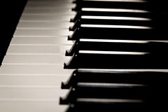 Beautiful new baby grand piano keyboard, ready to be played. Royalty Free Stock Photo