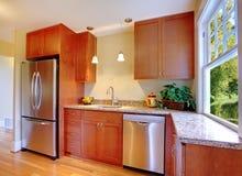 Beautiful new cherry kitchen with hardwood Royalty Free Stock Photos