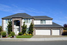 Beautiful New Home. Newly constructed upscale home complemented by deep blue sky royalty free stock photography