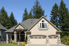 Beautiful New Home. Newly constructed upscale home complemented by deep blue sky royalty free stock image