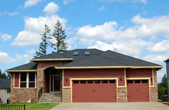 Beautiful New Home. Newly constructed upscale home complemented by deep blue sky royalty free stock images