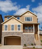 Beautiful New Home. Newly constructed upscale home complemented by deep blue sky stock image