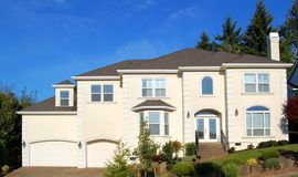 Beautiful New Home. Newly constructed upscale home complemented by deep blue sky stock photos