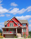 Beautiful New Home. Newly constructed upscale home complemented by deep blue sky royalty free stock photo