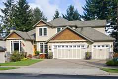 Beautiful New Home. Newly constructed upscale home complemented by deep blue sky stock photography