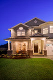 Beautiful New Home. A clear evening provides a beautiful setting for this luxurious new home stock photos