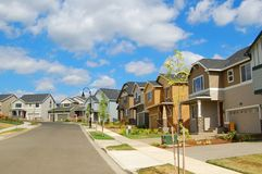 Beautiful New Homes. Newly constructed upscale homes complemented by deep blue sky stock images