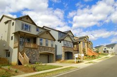 Beautiful New Homes. Newly constructed upscale homes complemented by deep blue sky stock photo