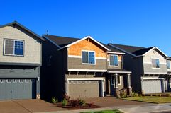Beautiful New Homes. Newly constructed upscale homes complemented by deep blue sky royalty free stock images