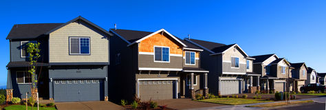 Beautiful New Homes. Newly constructed upscale homes complemented by deep blue sky royalty free stock photos