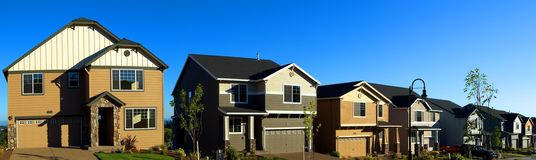 Beautiful New Homes. Newly constructed upscale homes complemented by deep blue sky royalty free stock photo