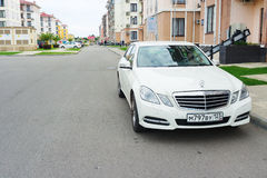 Beautiful new luxury business-class auto Mercedes Benz parked near the house. Stock Image