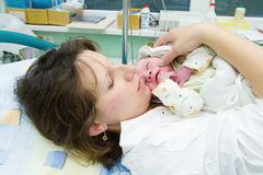 Beautiful new mother happy Stock Photography