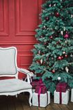 Beautiful New Year decorated classic home interior. Winter background. Living room with a Christmas decor. Holiday background. New royalty free stock images