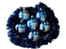Beautiful New Year's ornaments. Lie on a dark blue rain stock photo