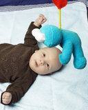 Sweet newborn baby with a soft toy Stock Image