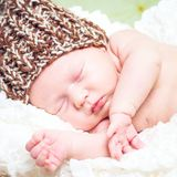 Beautiful newborn baby boy sleeping in knitted cap Royalty Free Stock Image
