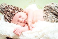 Beautiful newborn baby boy sleeping in knitted cap Royalty Free Stock Images