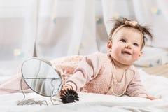 Beautiful newborn baby girl with hairbrush stock photos