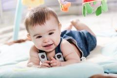 Beautiful newborn baby girl having fun. Royalty Free Stock Photography