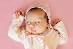 Beautiful newborn baby girl with pink hat and blue eyes closeup Royalty Free Stock Photos