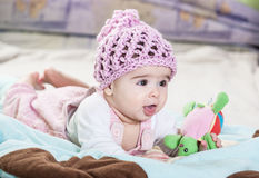 Beautiful newborn baby girl in pink hat. Royalty Free Stock Images