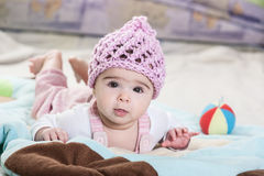 Beautiful newborn baby girl in pink hat. Royalty Free Stock Photos