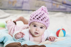 Beautiful newborn baby girl in pink hat. Stock Photography