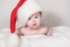 Beautiful newborn baby girl. In santa hat, christmas concept Stock Photo